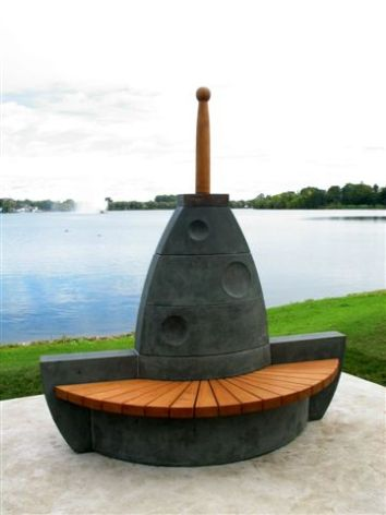 Bench, concrete, white oak & copper. Photo by Harold Glass